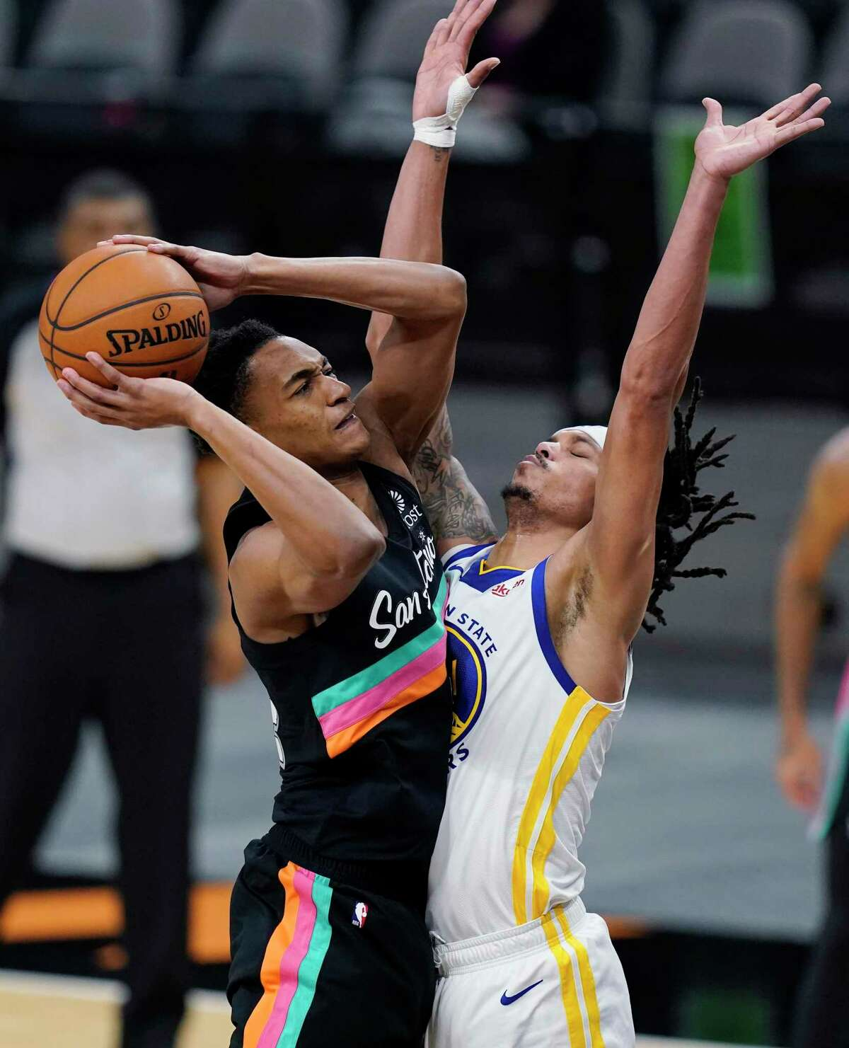 Devin Vassell, left, didn't shoot as well as he would've liked in Tuesday's loss to the Warriors, but he wasn't overmatched.