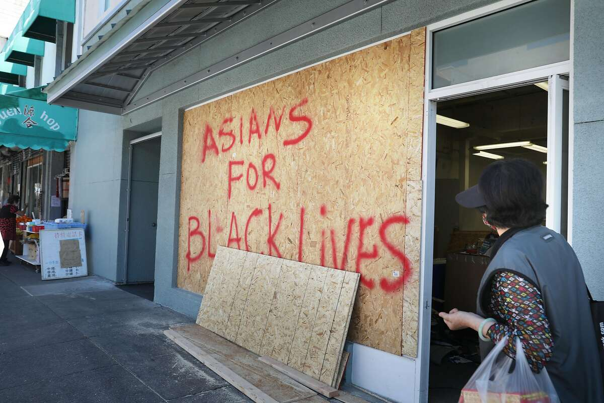Boards on businesses on Webster Street in Oakland's Chinatown last year convey community support for Black Lives Matter.