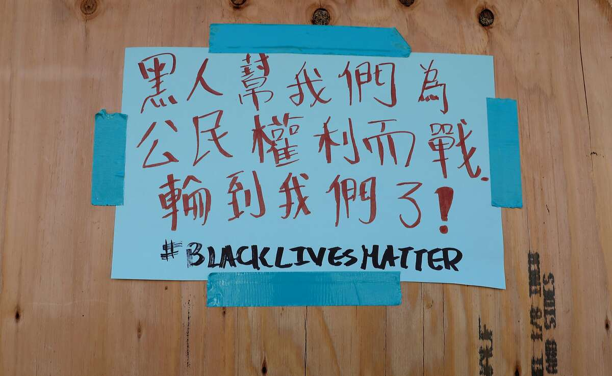 A sign seen at Yung Kee in Oakland's Chinatown last year conveys the community's support for Black Lives Matter.