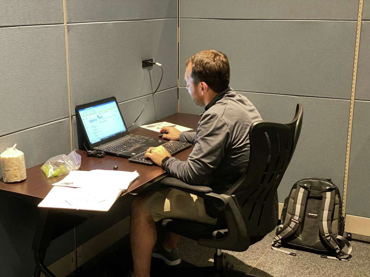 Clay Folloder, business development specialist for Big Daddy Foods, works in a cubicle at Kingsland Career Services in Katy. The free workspace is provided at Kingsland Baptist Church's central campus for people that are looking for jobs or need a quiet place to concentrate on their work.