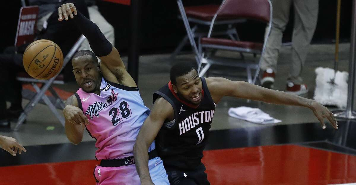 Houston Rockets guard Sterling Brown (0) battles against Miami Heat forward Andre Iguodala (28) during the fourth quarter of an NBA basketball game at Toyota Center, in Houston, Thursday, February 11, 2021. Rockets lost to the Miami Heat 101-94.