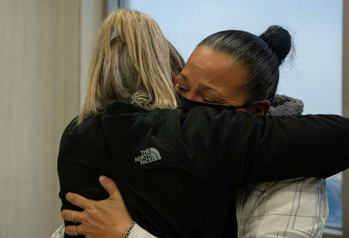 Shooting victim Delmar Rene Nolasco's half-sister, Alexis Rogers, hugs mom Leticia DelBosque at court Friday. Nolasco is one of 275 slaying victims of 2019 in Houston.