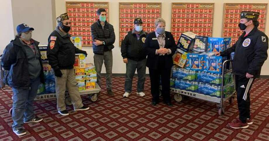 VFW Post 5691 in Collinsville donated 34 boxes of snacks and 20 cases of bottled water Friday to the Madison County Health Department's vaccination site.