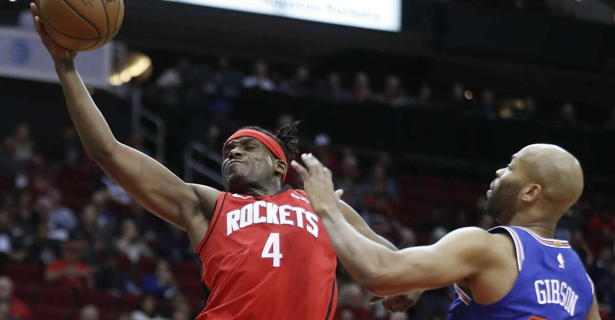Houston Rockets forward Danuel House Jr. (4) drives past New York Knicks center Taj Gibson (67) to the basket during the first half of an NBA basketball game on Monday, Feb. 24, 2020, at Toyota Center in Houston.