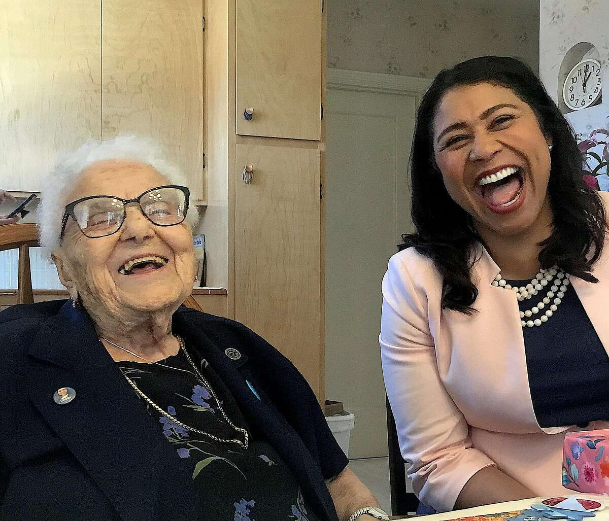 Lucy Mirigian visits with Mayor London Breed in 2018. Mirigian died Friday at age 114.