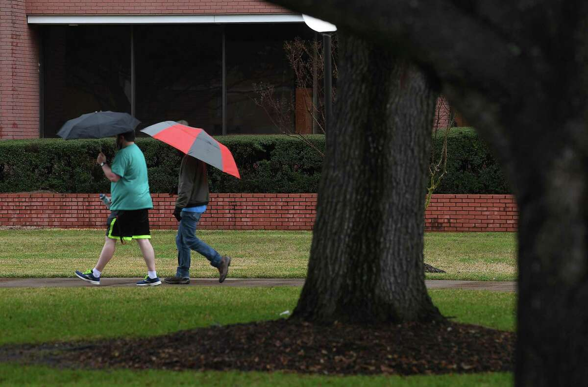 Students at Lamar University had rainy campus treks Thursday afternoon as showers and dropping temperatures moved into the region. Photo taken Thursday, February 11, 2021 Kim Brent/The Enterprise