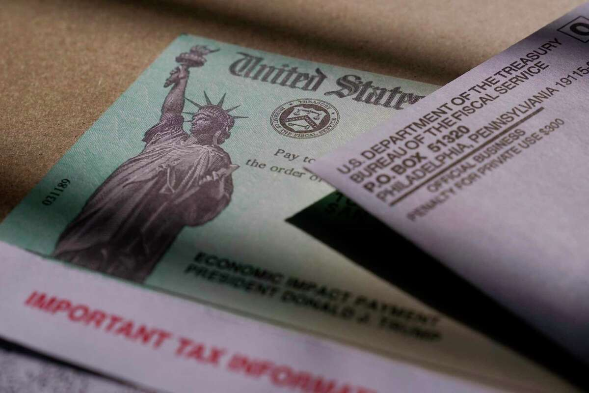 A stimulus check issued by the IRS to help combat the adverse economic effects of the COVID-19 outbreak is seen in San Antonio, Thursday, Jan. 28, 2021. (AP Photo/Eric Gay)