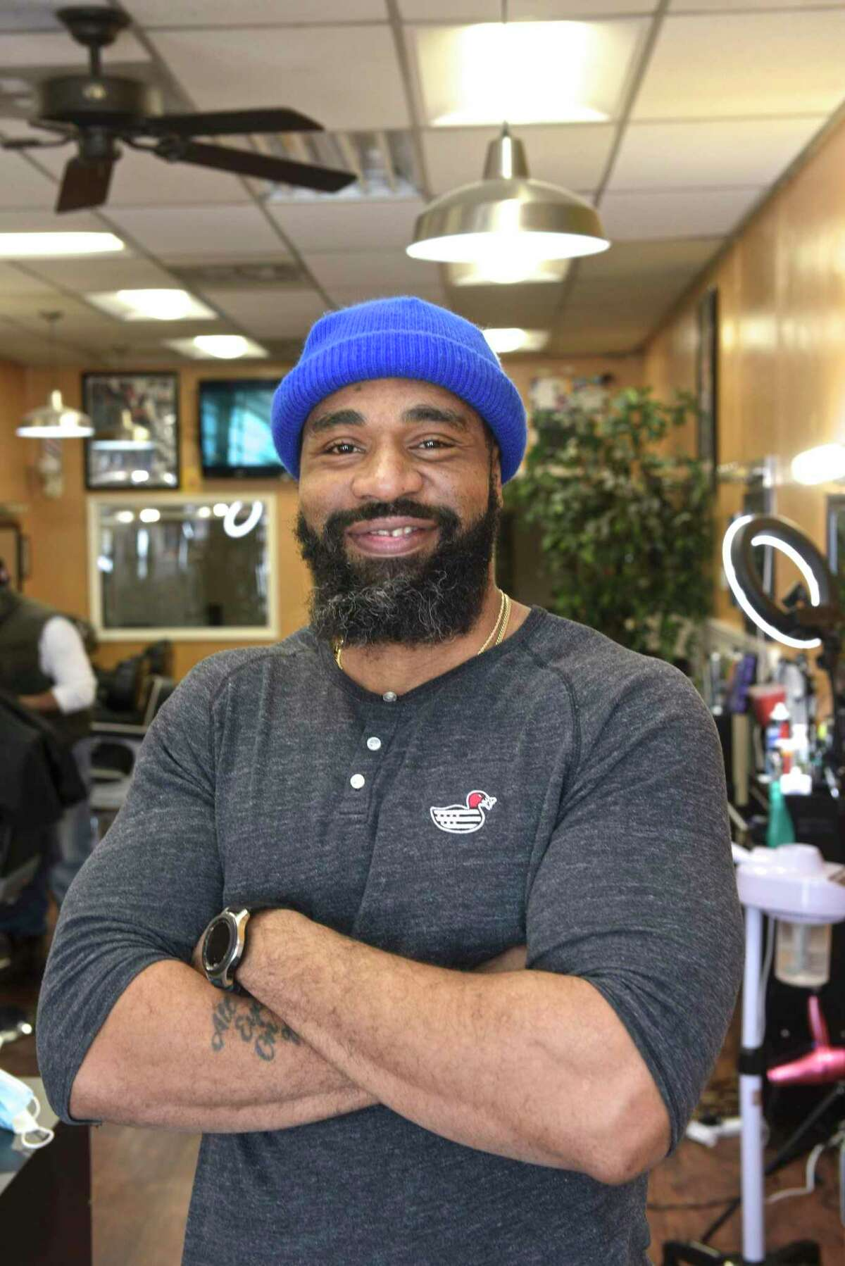 """Everton Stewart in his Barbershop on Friday afternoon. Stewart has had an apprentice in the shop. An effort led by U.S. Rep. Jahana Hayes that would update and expand the national apprenticeship program and bring an annual $2 million to Connecticut to promote the """"earn while you learn"""" model of vocational development. February 12, 2021."""