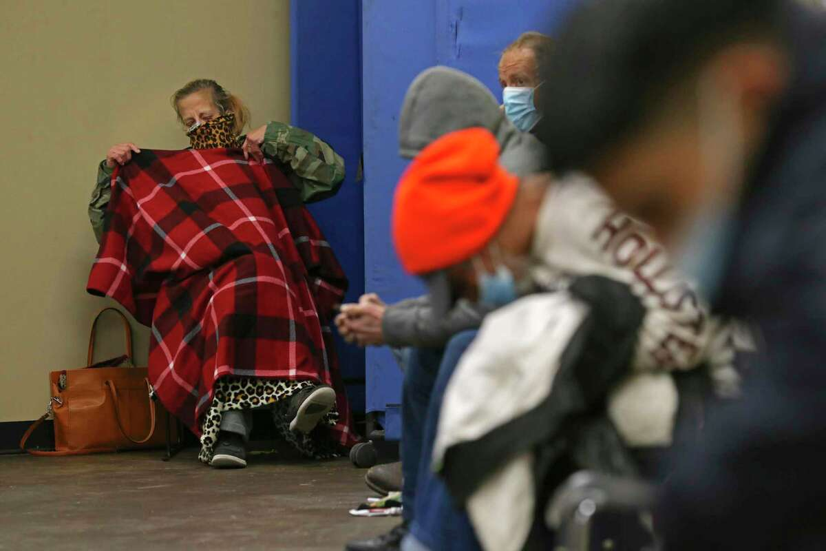 Michelle Manuel, 53, waits in the intake area of Haven for Hope on Friday, Feb. 12, 2021.