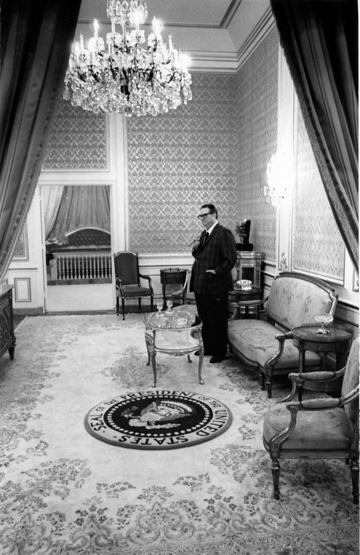 09/1968 - Roy Hofheinz stands in the 20-foot-ceilinged Presidential Suite at the Astrodome. The suite was across the elevator from Hofheinz's own living quarters and had a rug bearing the Presidential seal. Baths were trimed in purple velvet and toilet handles were made of gold. The suite, without a view, was built behind the scoreboard for security reasons.