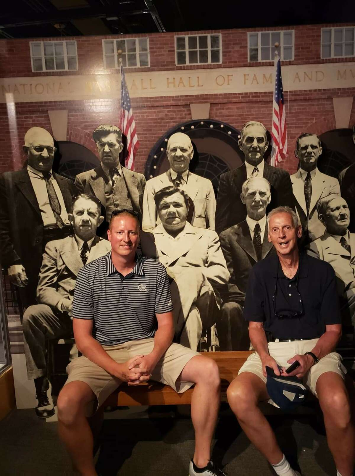 Travis Wilson, left, and his father, Greg Wilson, at the Hall of Fame for the induction of Mariano Rivera in 2019.