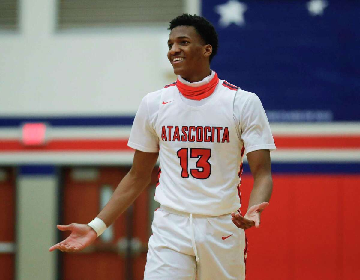 Atascocita's Justin Collins (13) reacts after a foul call during a high school basketball game at Atascocita High School, Friday, Feb. 12, 2021, in Atascocita.