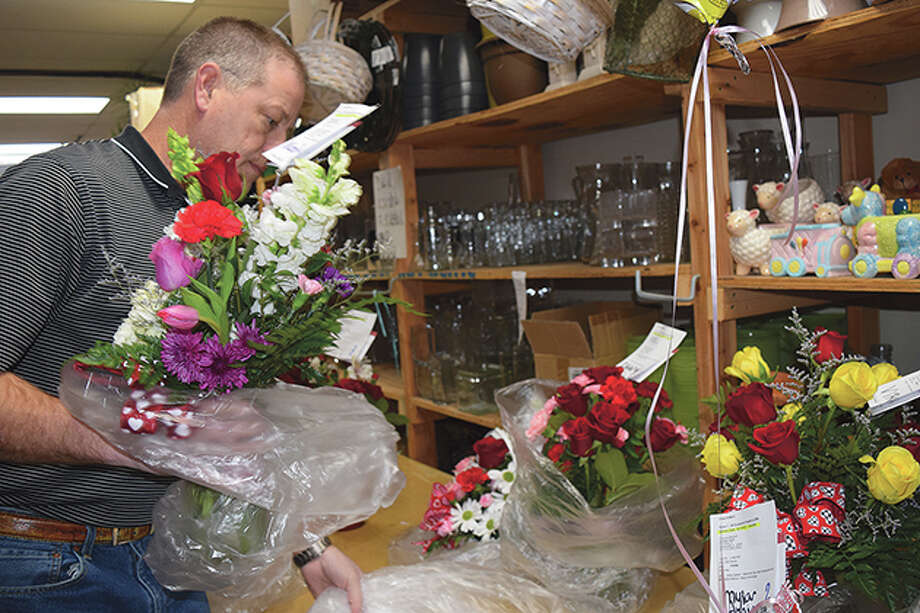 Brian Chumley packages bouquets of flowers Friday at All Occasions Flowers and Gifts in preparation for the Valentine's Day rush. Photo: Samantha McDaniel-Ogletree | Journal-Courier