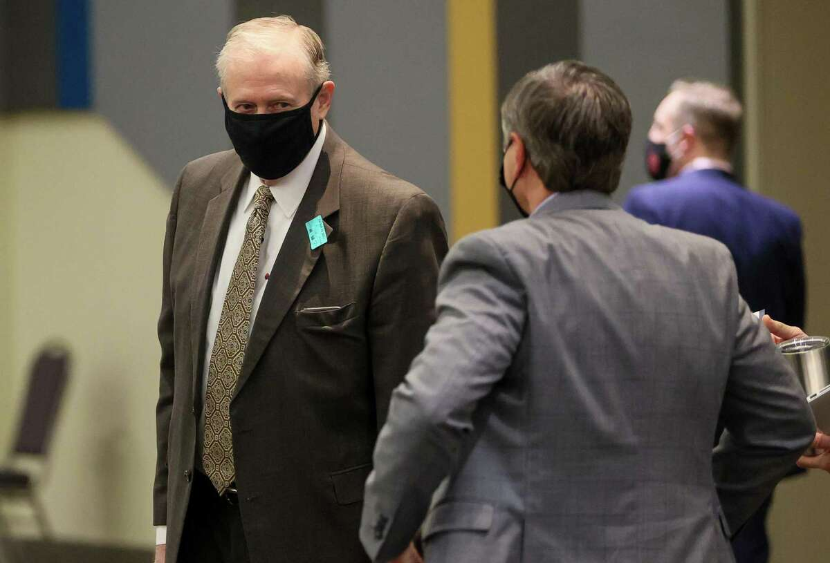 Ron DeLord, left, chief negotiator for the San Antonio Police Officers Association, arrives for the first meeting in a round of negotiations over a new police contract between the SAPOA and the City of San Antonio at the Convention Center on Friday, Feb. 12, 2021. Negotiations are scheduled to continue through mid-April.