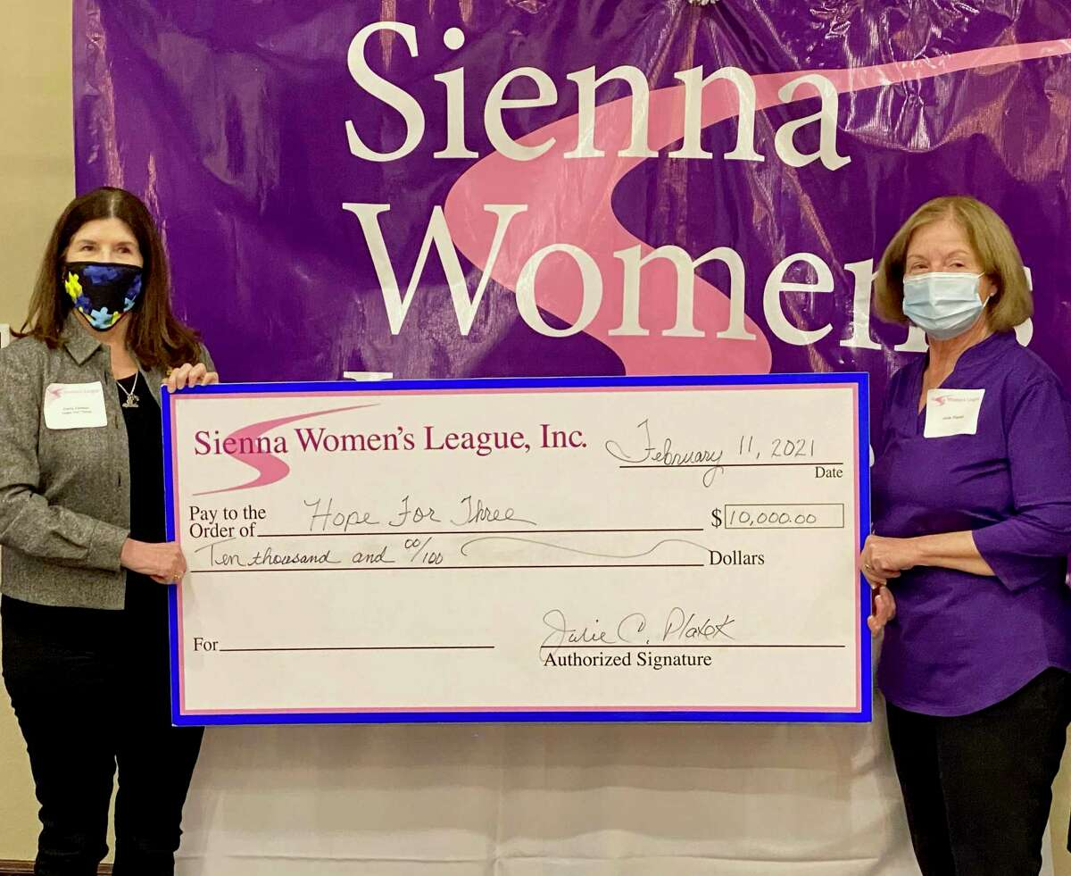 Darla Farmer, CEO of Hope For Three, is pictured here with Julie Platek, president of Sienna Women's League.