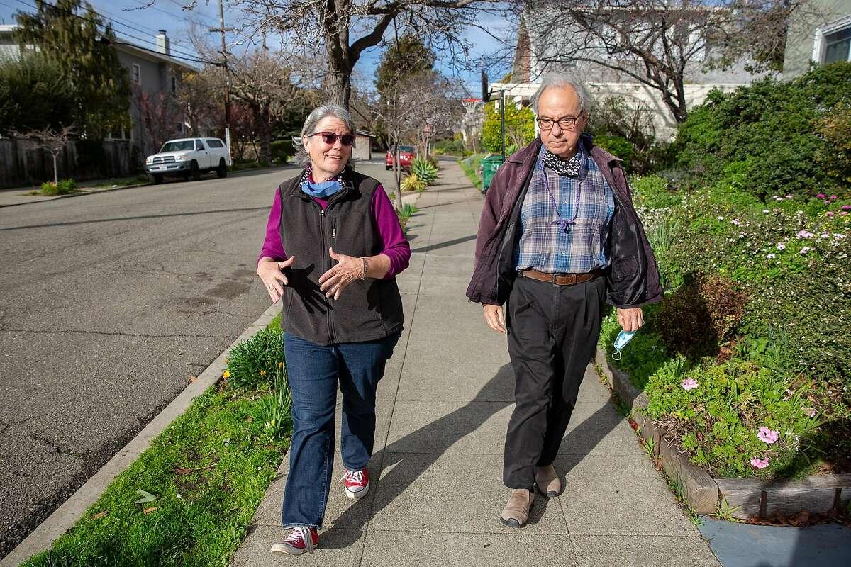 Kaiser Permanente members Janine Bajus and John Culver go for their daily walk near their Berkeley home.