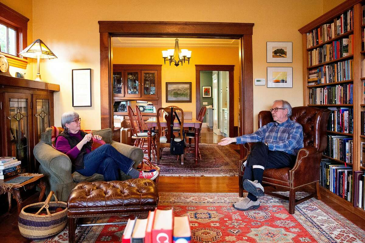John Culver talks with his wife, Janine Bajus, at their home. He said getting a vaccine