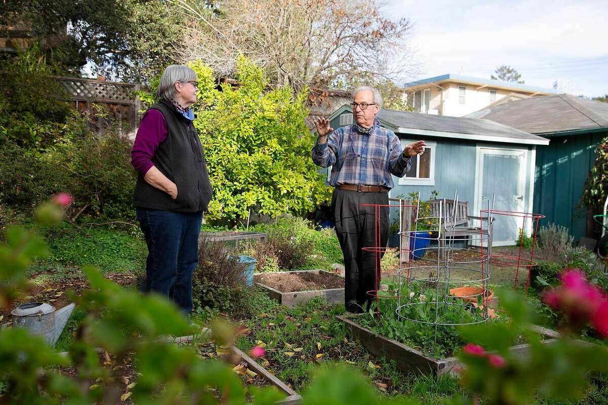 John Culver and wife Janine Bajus talk in the backyard of their Berkeley home.