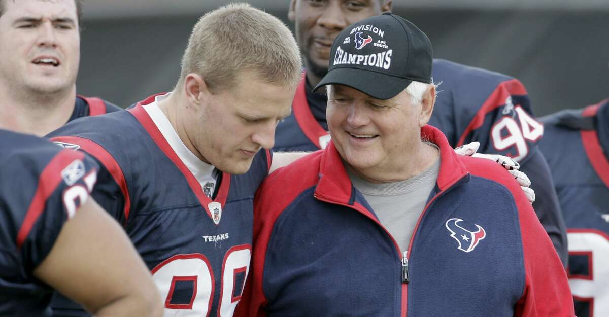 Houston Texans defensive coordinator Wade Phillips, right, is hugged by defensive end J.J. Watt (99) after an NFL football practice Wednesday, Dec. 14, 2011, in Houston. Phillips will take a medical leave due to a scheduled surgical procedure later this week. He is expected to return later this season. (AP Photo/David J. Phillip)