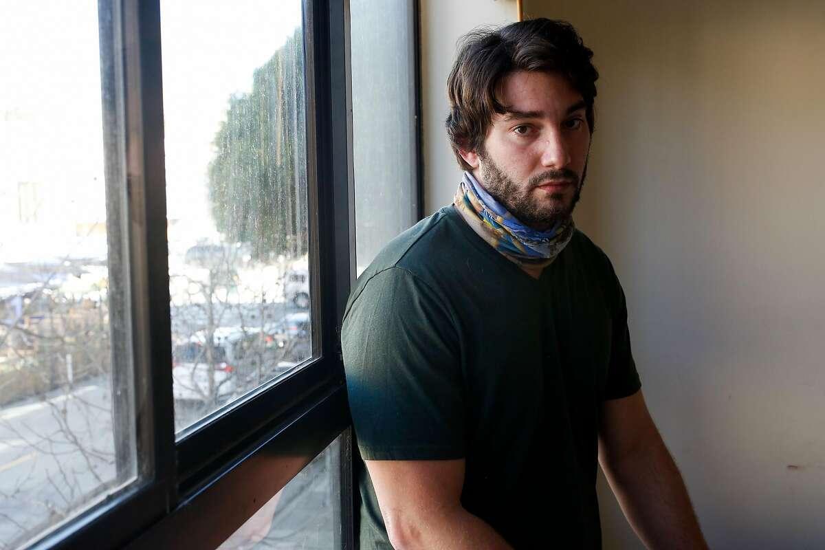 Kieran Blubaugh in his Russian Hill apartment Friday as he prepares for his move to Dallas.
