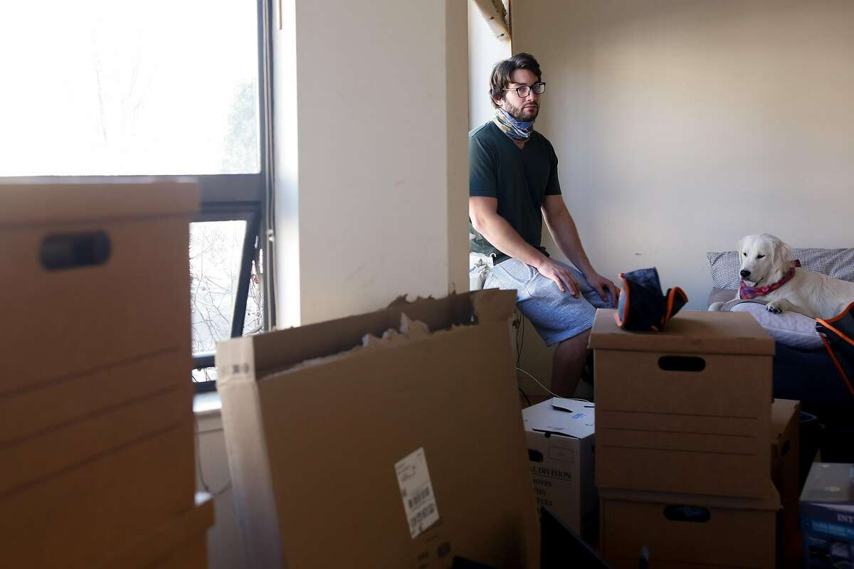 Kieran Blubaugh as he packs up his Russian Hill apartment Friday and prepares for his move to Dallas.