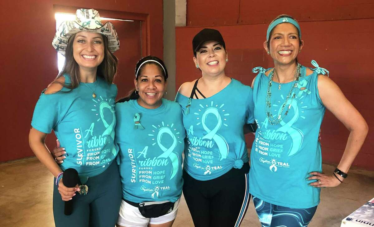 Roma Villavicencio (left) celebrates with a group of ovarian cancer survivors during a 2019 run/walk fundraiser at which she was the master of ceremonies.