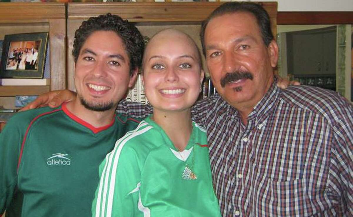 While being treated with chemotherapy for ovarian cancer, Roma Villavicencio (center) posed with her Uncle Tito and brother Nacor in 2009.