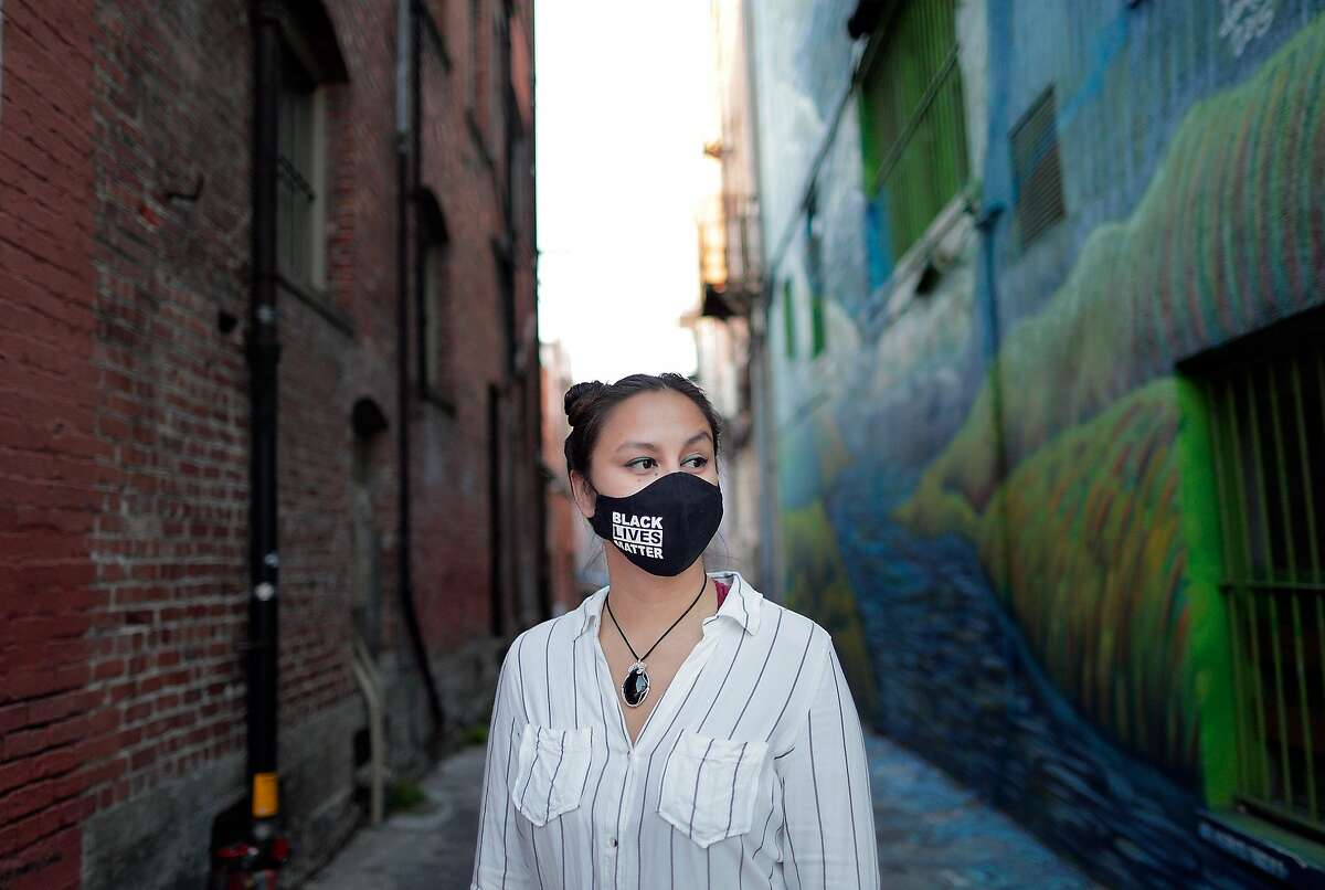 Kimi Stout wearing her Black Lives Matter face mask that she says she felt pressured to quit her job over in her home town of Petaluma, Calif., on Wednesday, February 10, 2021. In September, Stout says she was told she could not wear her BLM mask at her job at The Girl & The Fig abruptly after having done so for months and with seeming approval from the owner. But then a mask policy was implemented after a customer complained to the owners of the Sonoma restaurant.