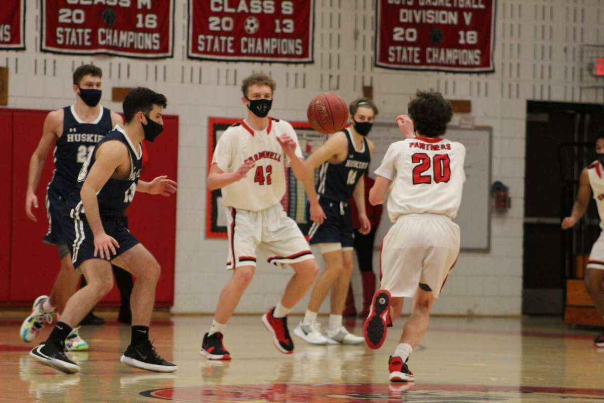 Cromwell's Connor Daly finds JJ Fehan in the heart of Morgan's defense with this fourth-quarter pass on Friday.
