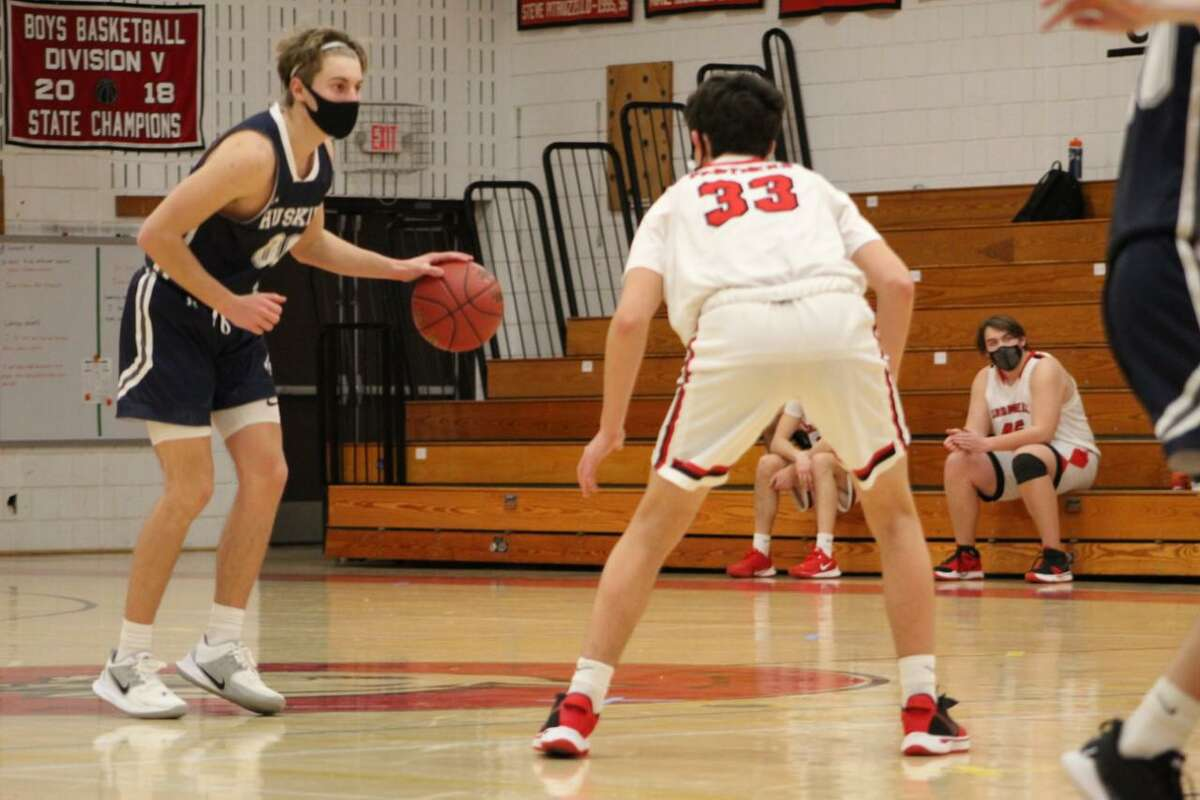 Drew Nye sets up Morgan's offense as Comwell's Gianluca Albert defends in the third quarter on Friday.