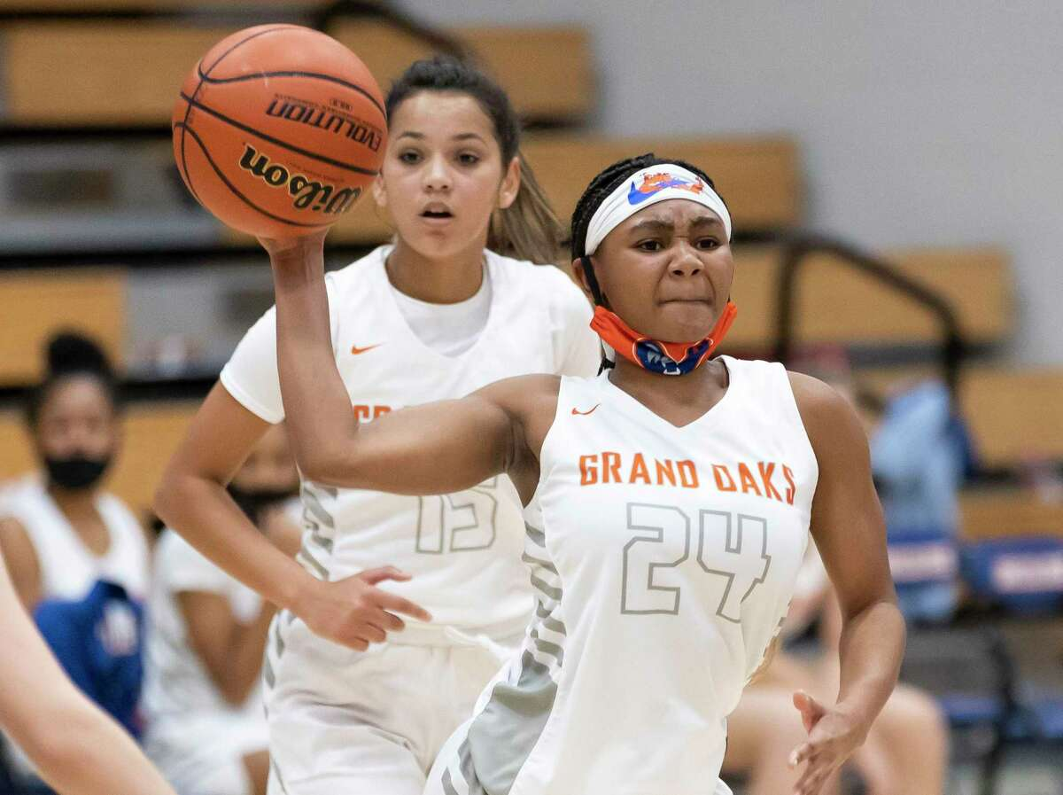 FILE - Grand Oaks shooting guard Kaitlyn Stewart (24) passes the ball during the second quarter of a non-district girls basketball game against New Caney at Grand Oaks High School in Spring.