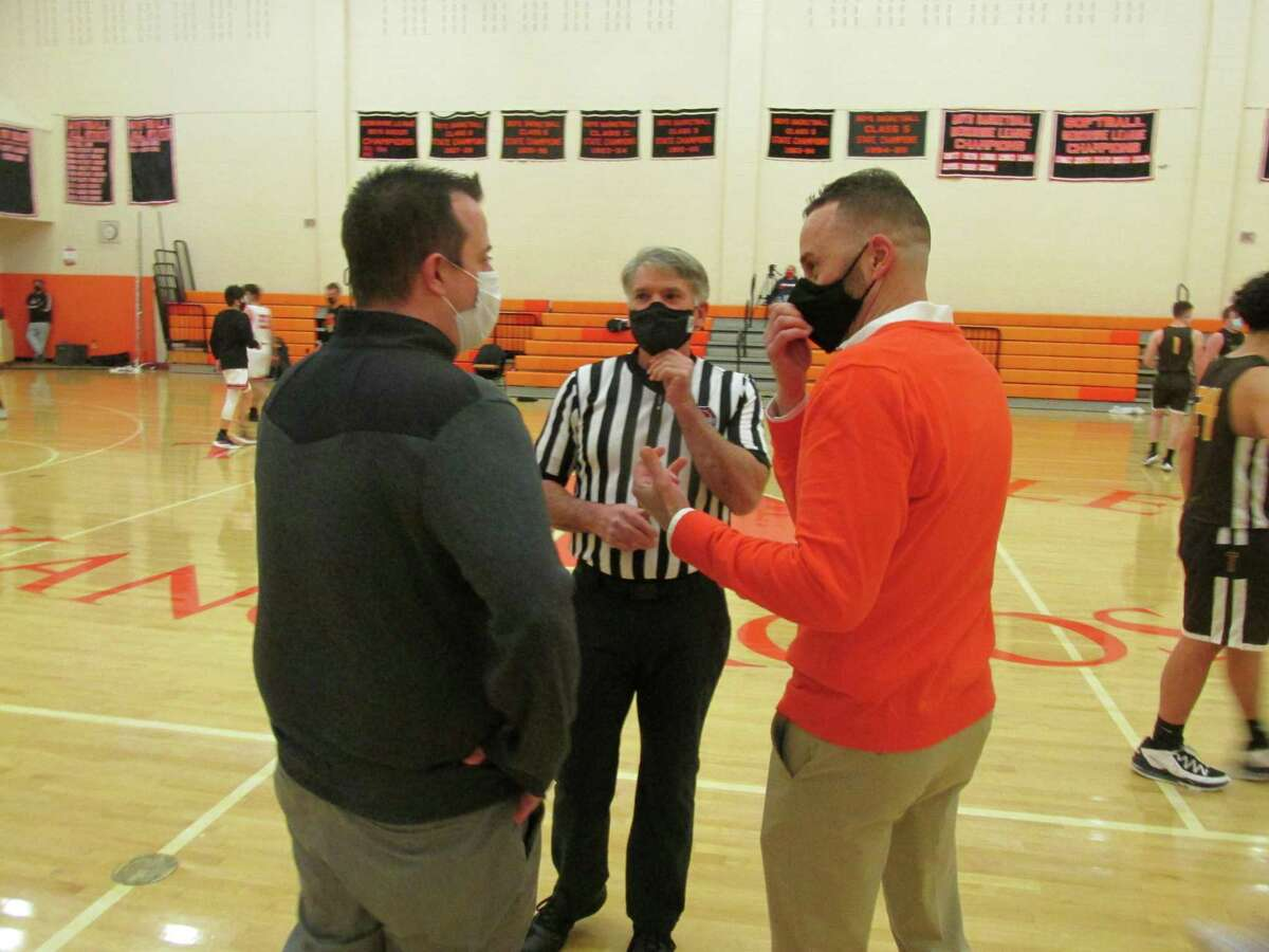 Thomaston coach A.J. Bunel, left, and Terryville coach Mark Fowler, rivalry veterans from their own playing days, talk COVID protocols with referee Terry Musselman before Terryville's win on Friday.