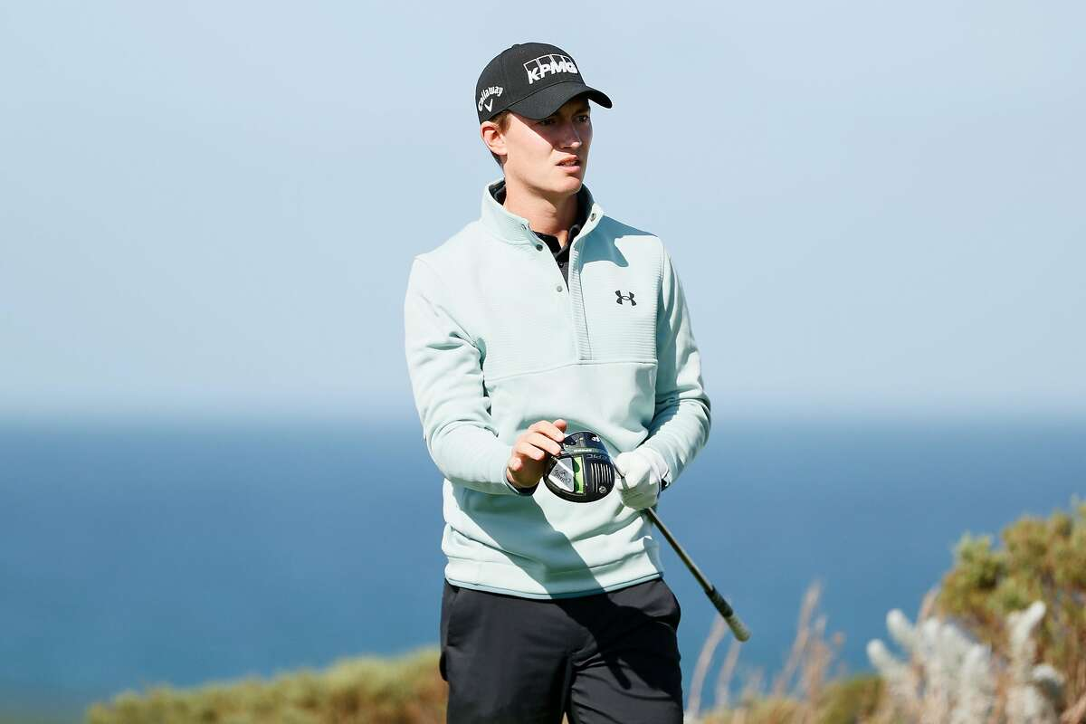 Maverick McNealy plays his shot from the sixth tee Friday at Spyglass Hill. McNealy shot 69 and heads into the weekend tied for eighth in the AT&T Pebble Beach Pro-Am.