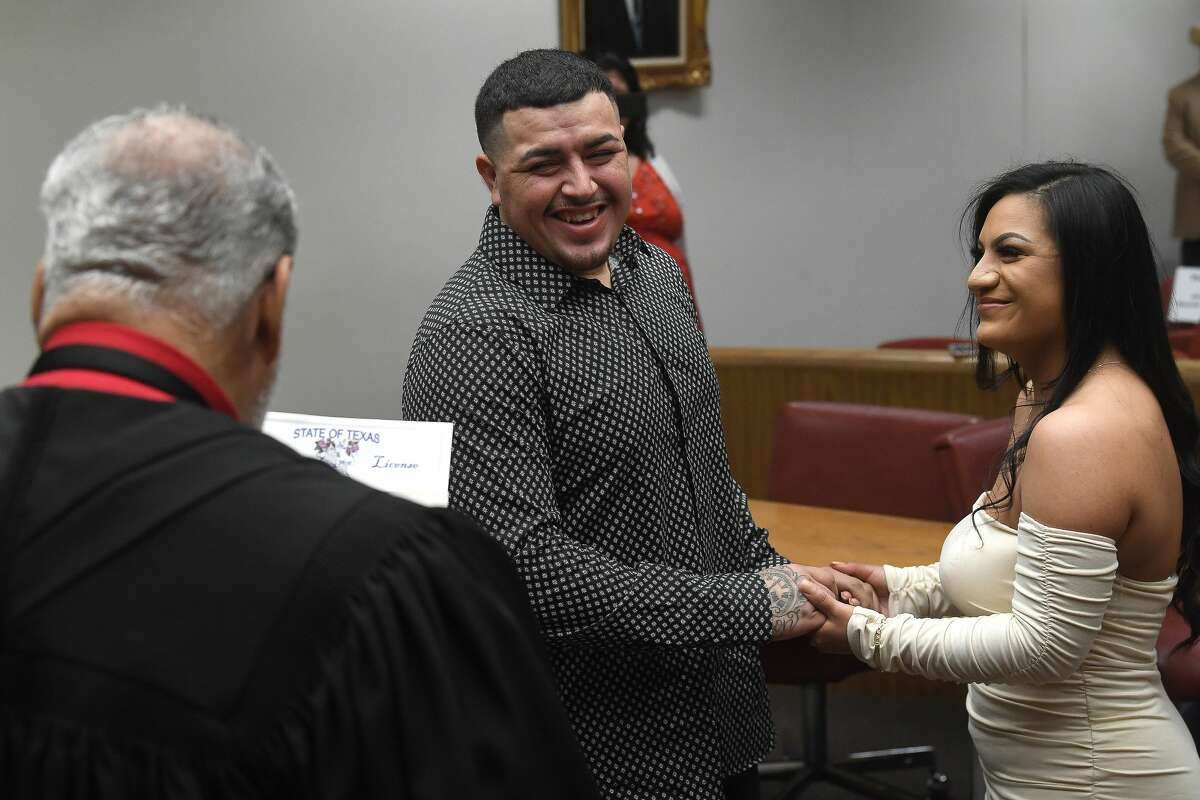Eddie and Gloria Gomez laughs as they are officially wed during their wedding ceremony in Justice of the Peace Benjamin