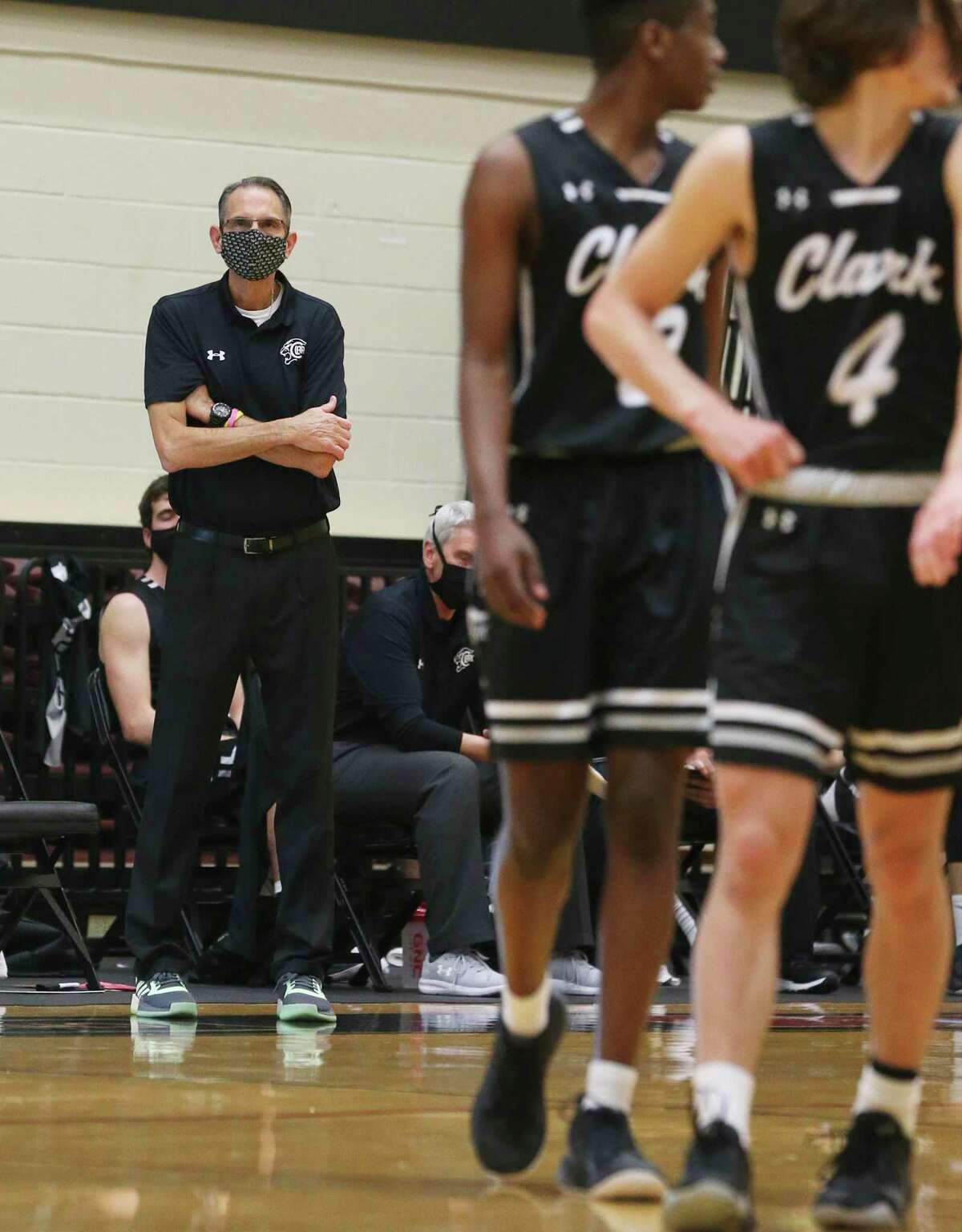 Clark basketball coach Steve Sylestine keeps an eye on his players against Johnson during their 28-6A playoff seeding basketball game at Littleton Gym on Friday, Feb. 12, 2021. Clark defeated Johnson, 69-62, to move on.