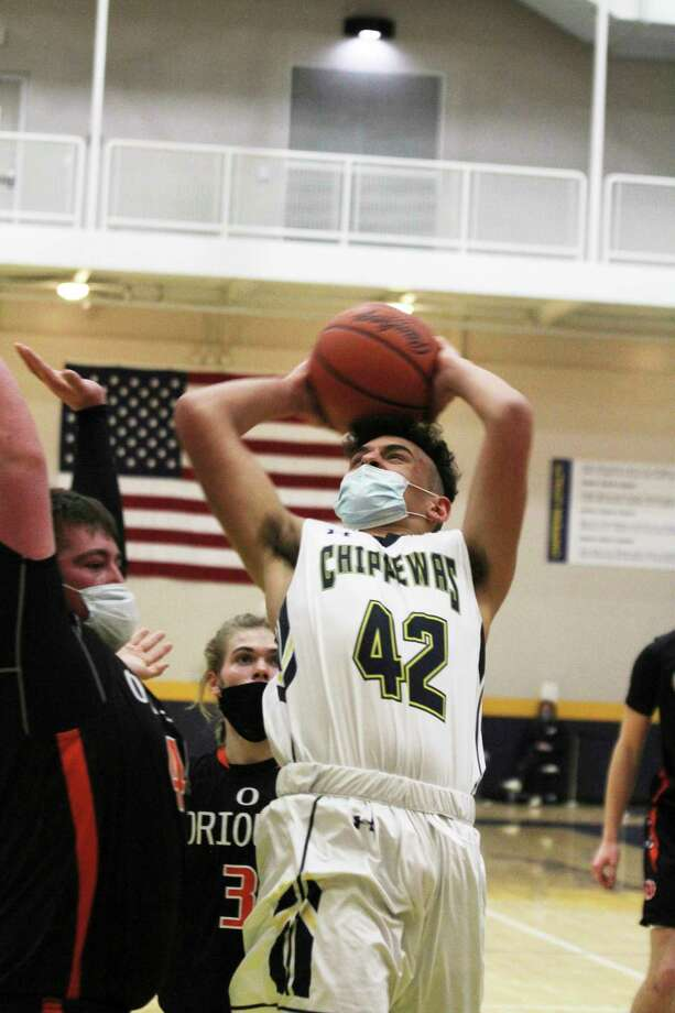 The Chippewas' Trevor Mikula goes up for a shot in the third quarter Friday in Manistee's loss to Ludington. (Dylan Savela/News Advocate)