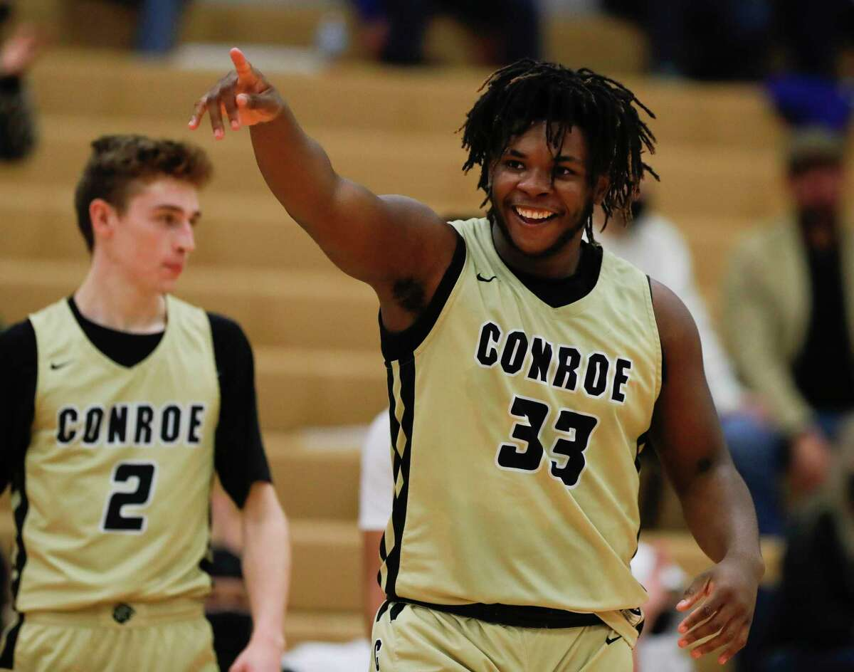 Conroe's Kamari Weatherspoon (33) geatures toward his bench after being fouled while shooting a 3-pointer during the second quarter of a District 13-6A high school basketball game at Oak Ridge High School, Friday, Feb. 12, 2021.