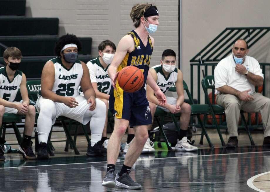 Aaron Sowles and the Bad Axe varsity boys basketball team topped Laker 59-46 on Friday night. Photo: Mark Birdsall, Mark.birdsall@hearstnp.com
