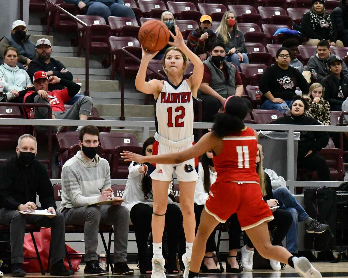Majik Esquivel banks in one of her eight 3-pointers during Plainview's 73-46 rout of Lubbock Coronado on Friday at Abernathy in the bi-district round of the Class 5A girls basketball tournament.