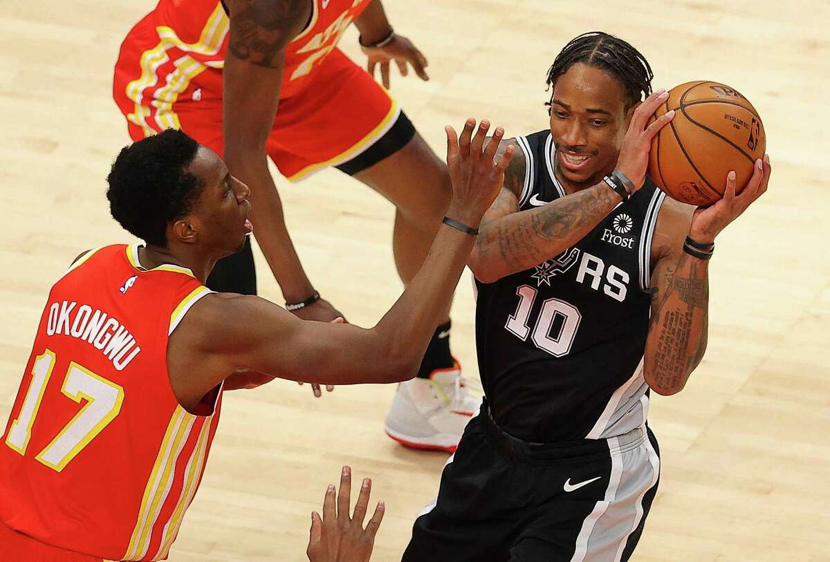 DeMar DeRozan put together a strong first half with 22 points, six rebounds and six assists to lead the Spurs past the Hawks on Friday in Atlanta.