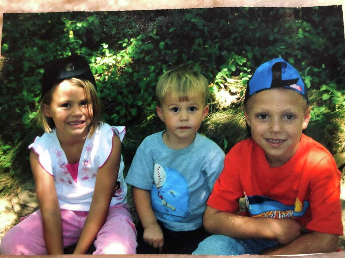 Saylor Poffenbarger (at age 4) with her brother, Fordham (2) in the middle and oldest brother, Reese (6).