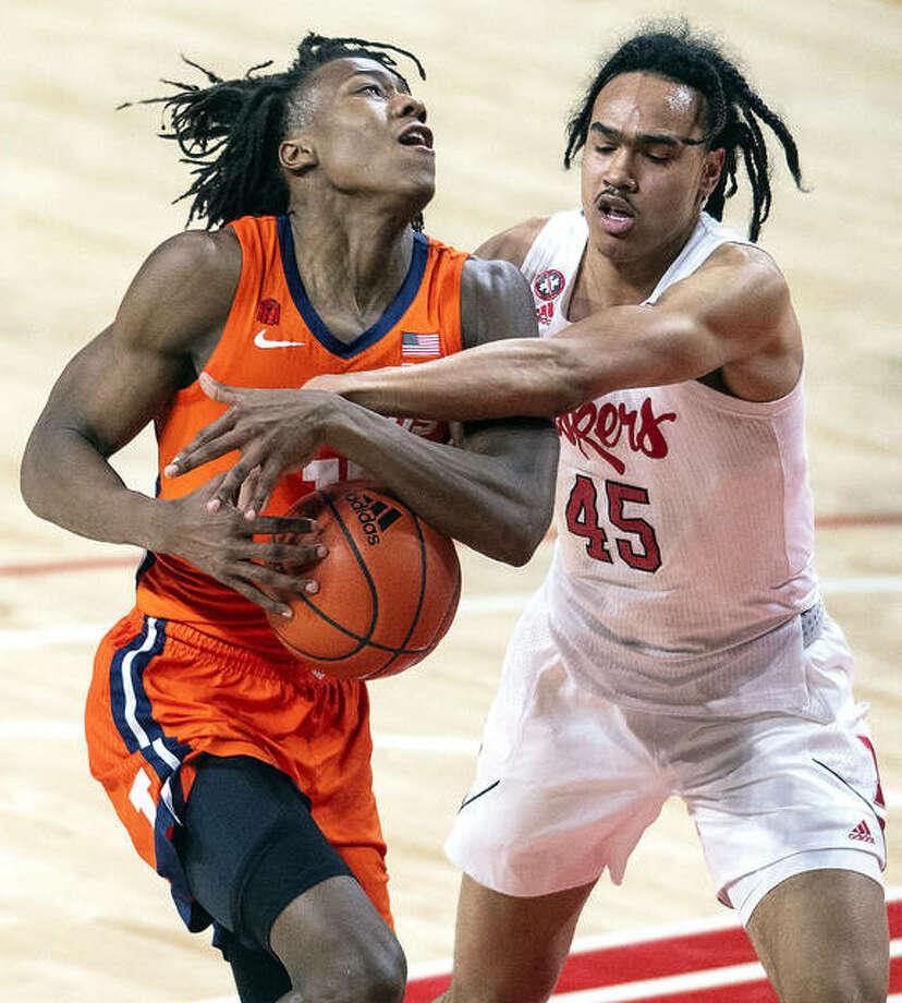Illinois' Ayo Dosunmu (11) is fouled by Nebraska guard Dalano Banton (45) Friday night in Lincoln, Neb. Photo: Associated Press