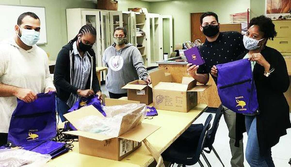 Domus Kinghts and Domus Vikings staff packed more than 100 bags for their students in the summer of 2000 in Stamford, Connecticut. The bags included notebooks, hand sanitizer, headphones and masks.