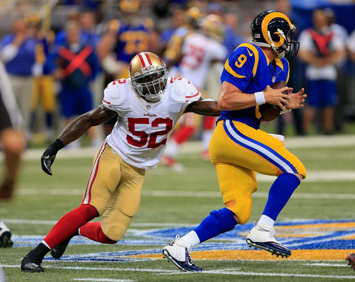 St. Louis Rams quarterback Austin Davis (9) is pressured by San Francisco 49ers inside linebacker Patrick Willis (52) in the second quarter of an NFL football game Monday, Oct. 13, 2014, in St Louis. (AP Photo/Billy Hurst)