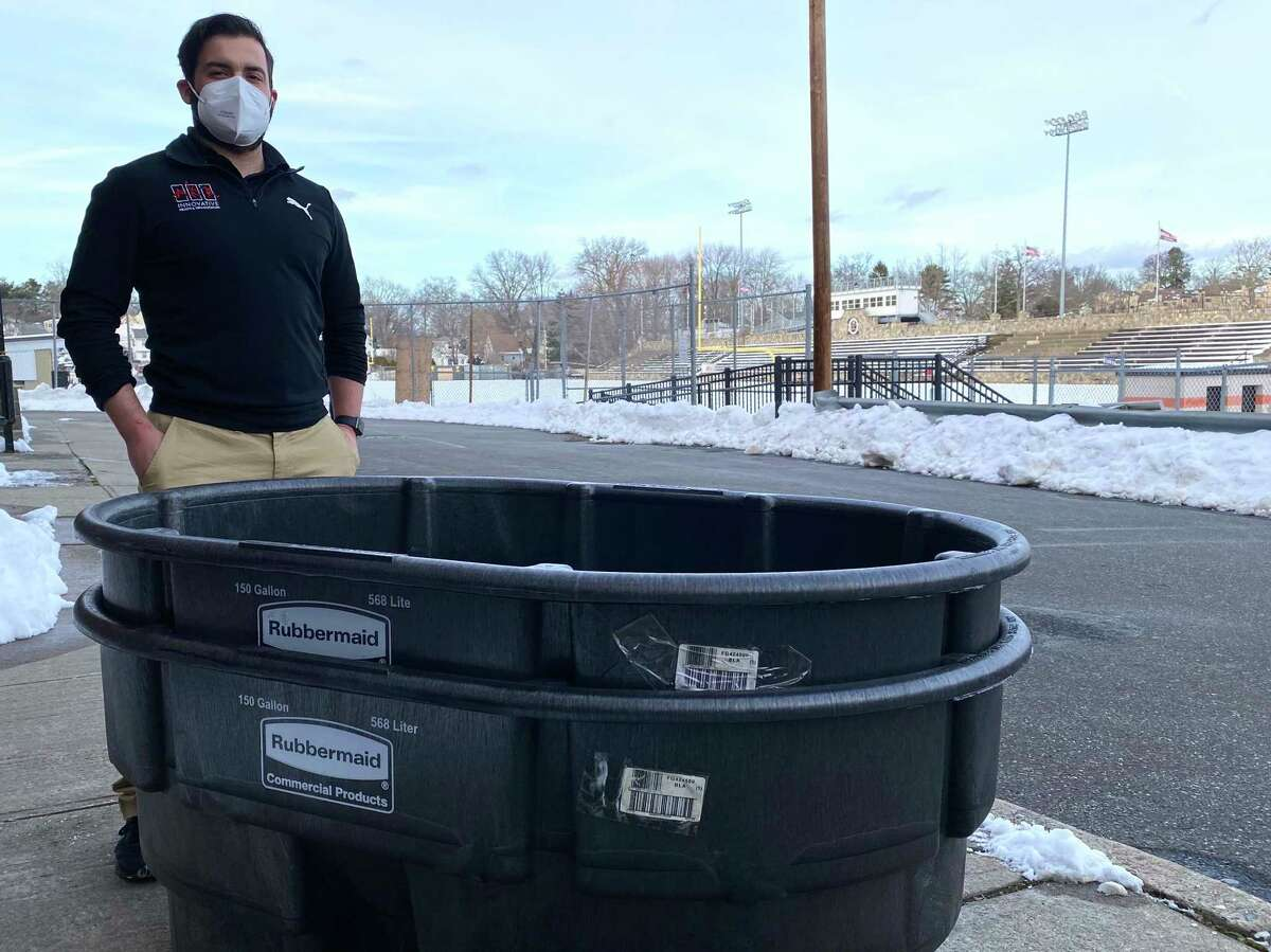 Stamford trainer Jordan Napolitano outside of Boyle Stadium with a cooling tub donated by the CIAC to be used if a student athlete suffers heat-related illness.