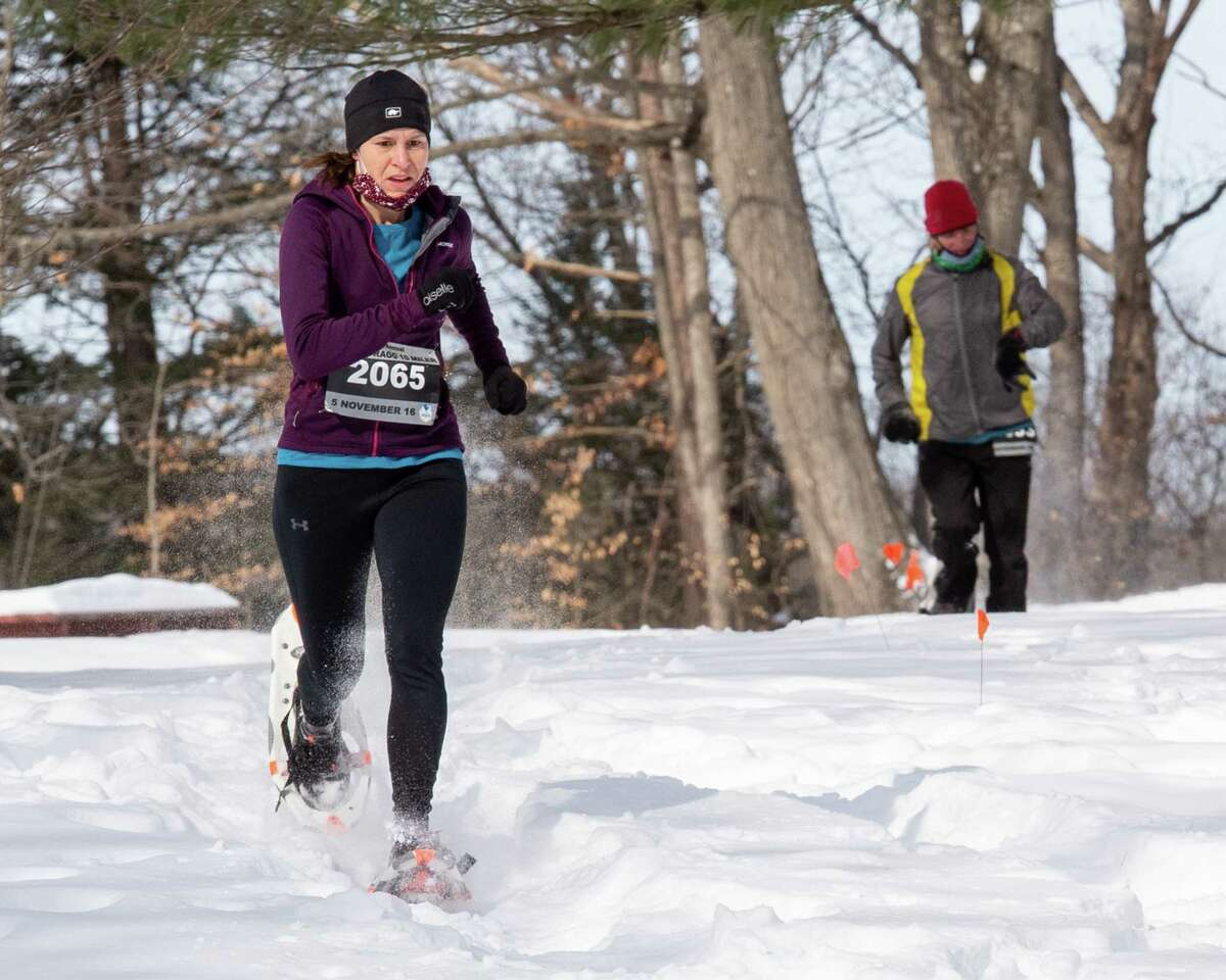 Joy McManaman, of Schenectady, competes in the Brave the Blizzard 5K Snowshoe Race at Tawasentha Park in Guilderland, NY, on Saturday, Feb. 13, 2021 (Jim Franco/special to the Times Union.)