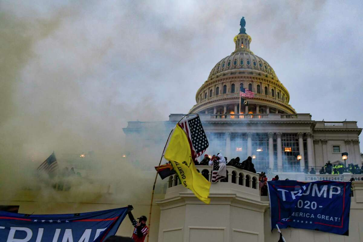 Supporters of President Donald Trump storm the Capitol on Jan. 6. Democrats in the U.S. Senate failed to reach the 67 votes needed to find him guilty Saturday.