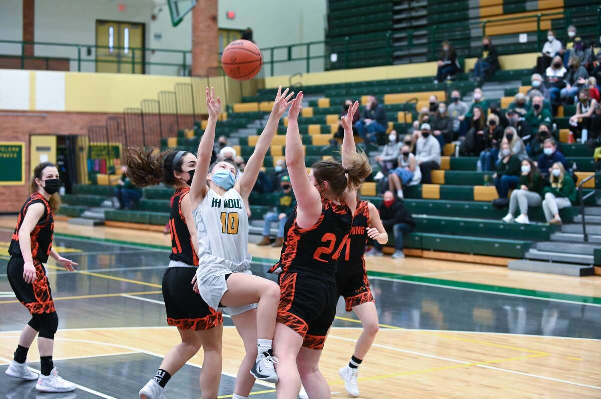 Dow's Chloe McVey takes a shot during the Chargers' game against Flushing Saturday, Feb. 13, 2021 at H. H. Dow High School. (Katy Kildee/kkildee@mdn.net)