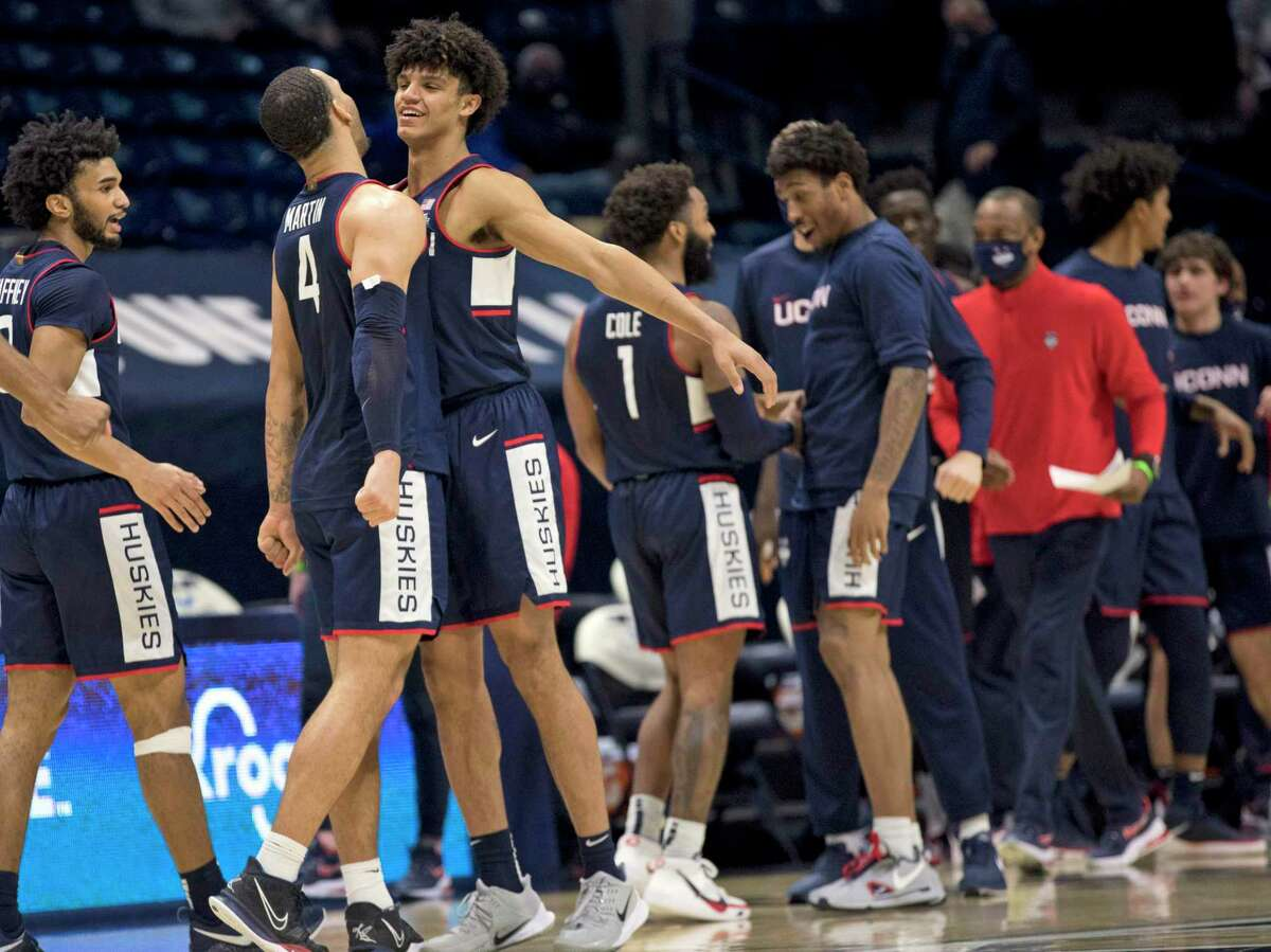 UConn's Andre Jackson, third from left, and Tyrese Martin (4) celebrate after Saturday's win over Xavier in Cincinnati.