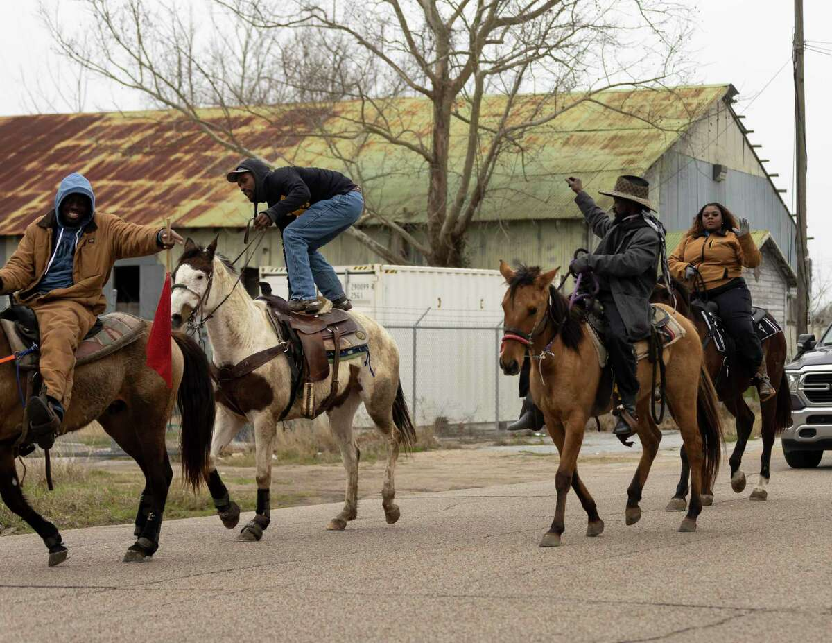 Horse riders participate in Conroe's annual Black History Parade, Saturday, Feb. 13, 2021, near downtown Conroe. The parade started near the Conroe library and concluded at Booker T. Washington High School with an award presentation.
